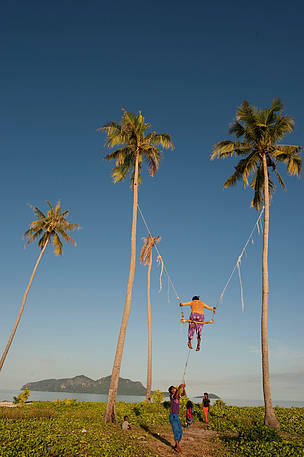 Very high swing in Sibuan Island inhabited by Bajau Laut sea gypsies. Semporna, Sabah, Malaysia.