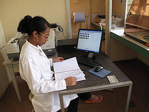 Woman scientist working on assessing the carbon of ground biomass. IRD laboratory, Antananarivo. Madagascar.